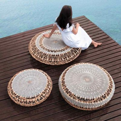 rattan stool, dreamcatcher by Kenneth Cobonpue