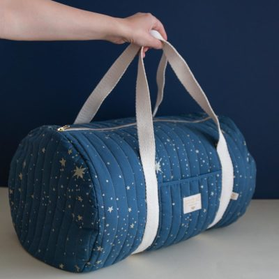 blue maternity bag with gold stars in organic cotton by Nobodinoz