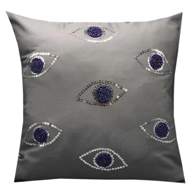 grey cushion with embroidered blue eyes