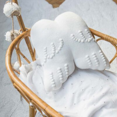 Knitted cushion white angel wings by Lorena Canals