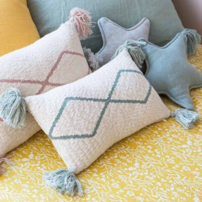 Knitted cushion natural and blue by Lorena Canals