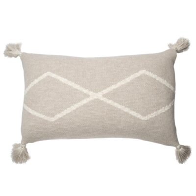 Knitted rectangular cushion with pompom linen by Lorena Canals