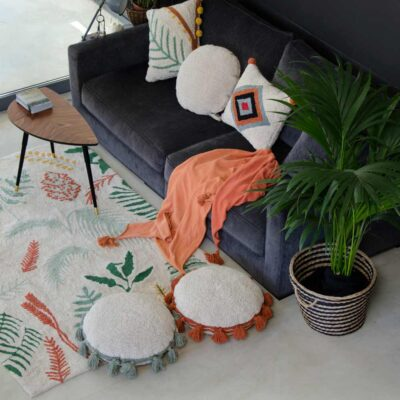 Washable cushion circle with orange pompom by Lorena Canals