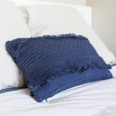 Washable knitted cushion blue by Lorena Canals