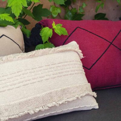 Washable knitted cushion white by Lorena Canals