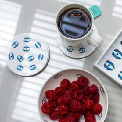 white round coasters with blue eyes by Casacarta