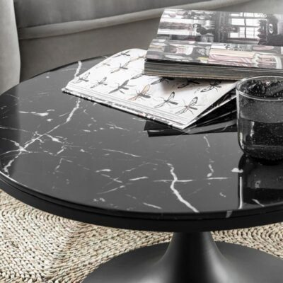 round coffee table with black marble glass top by Must Living