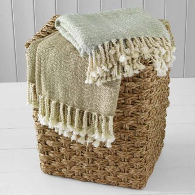 Throw woven in sage and cream to create a herringbone pattern with twisted tassels