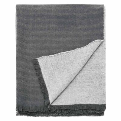 Reversible throw woven in charcoal and grey finished with a fringed edge