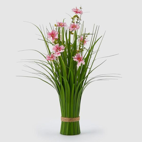Artificial grasses and pink flowers