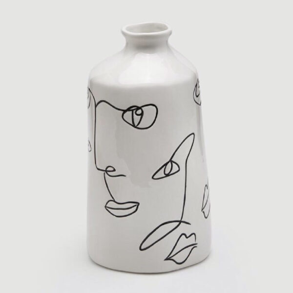 white vase with Picasso faces