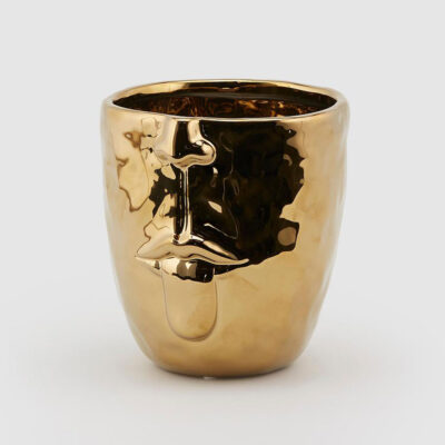 Tongue out gold face vase