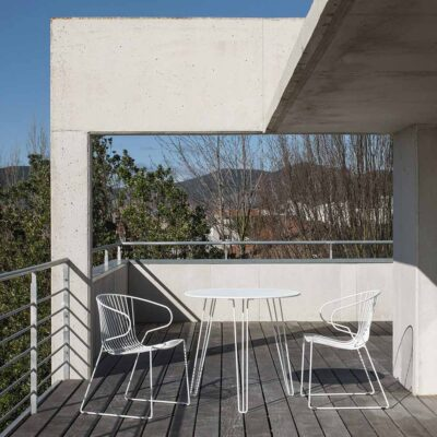 Menorca outdoor round dining table by Isimar
